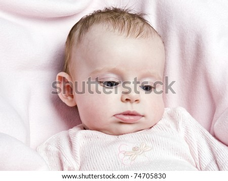 Cute newborn baby girl on pink background
