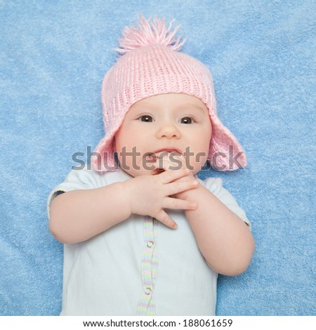 Cute newborn baby girl on the blue towel - stock photo