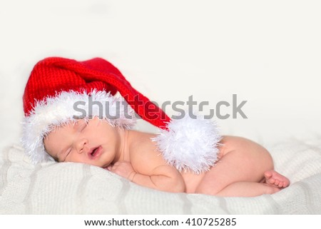 Cute newborn baby sleeps in a santa claus hat close-up  - stock photo