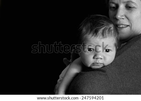 Cute newborn baby with mother - stock photo