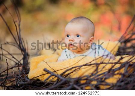Cute newborn baby with towel - stock photo