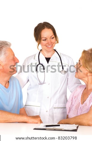 cute nurse stands near the old couple