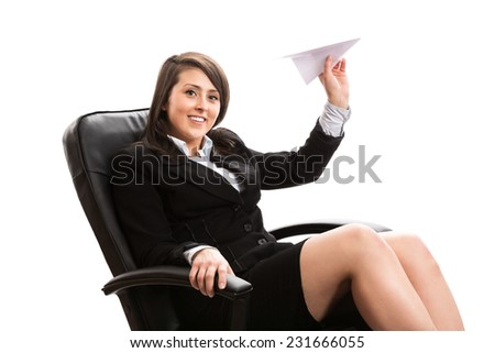 Cute office worker throwing paper plane - stock photo