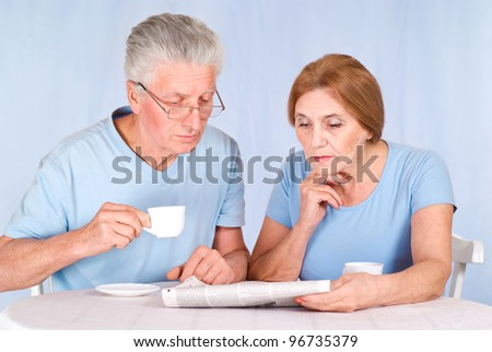 cute old couple at breakfast at table - stock photo