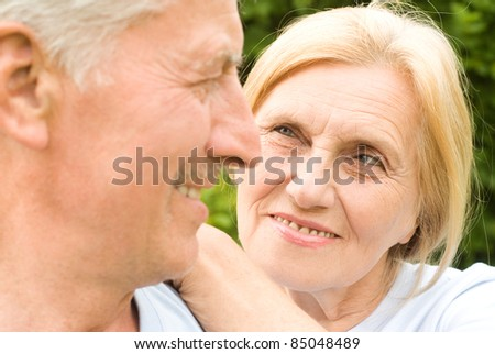 cute old couple posing at the nature