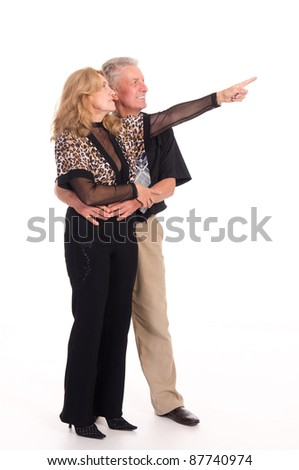 cute old couple standing on a white