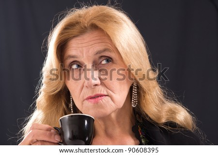 cute old woman posing on a black