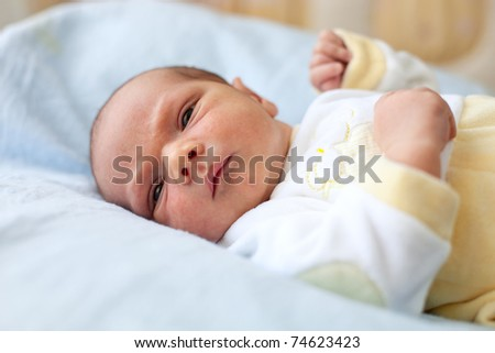 Cute one week old baby boy - stock photo