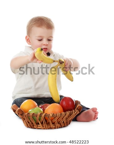 cute one year baby boy with fruit basket, isolated on white - stock photo