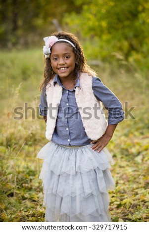 Cute outdoor portrait of a smiling African American little girl - stock photo