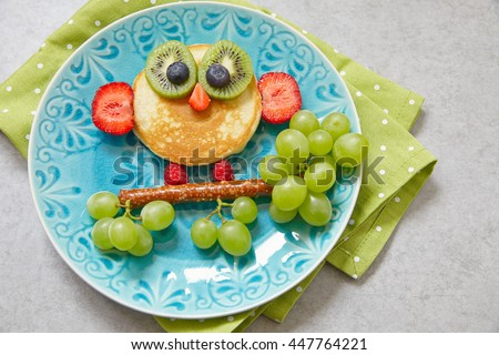 Cute owl pancake with fruits for kids breakfast - stock photo