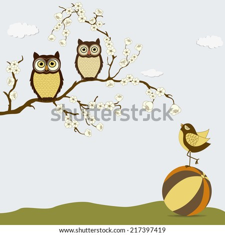 Cute owls on branch with bird on the ball - stock photo