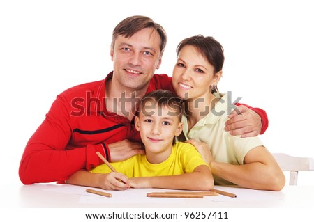 cute parents and kid drawing at table