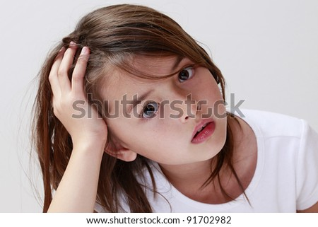 Cute, pensive child looking for help - stock photo