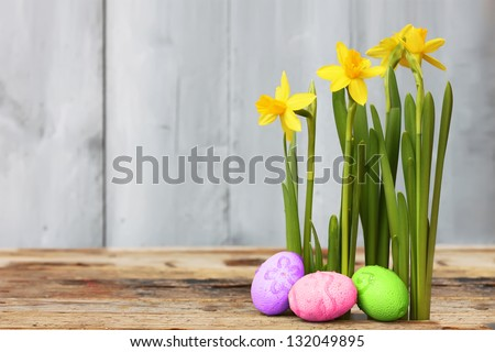 Cute photo with easter eggs and daffodils - stock photo