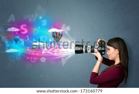 Cute photographer girl with camera and abstract imaginary - stock photo