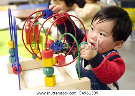 cute playing baby - stock photo
