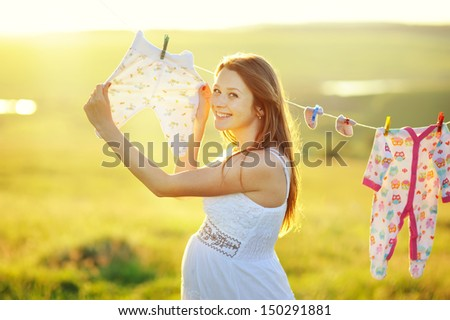cute  pregnant woman in decorated garden, sunny picture - stock photo