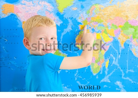 Cute preschool boy with world map