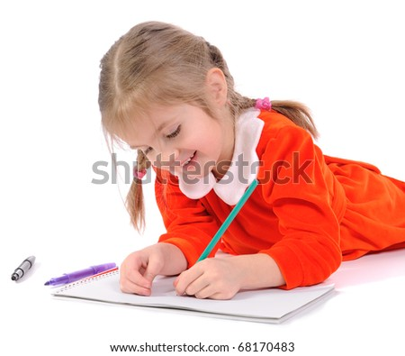 Cute preschool girl drawing with pencil on the floor. - stock photo
