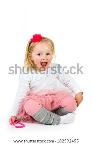 Cute preschool girl isolated on white