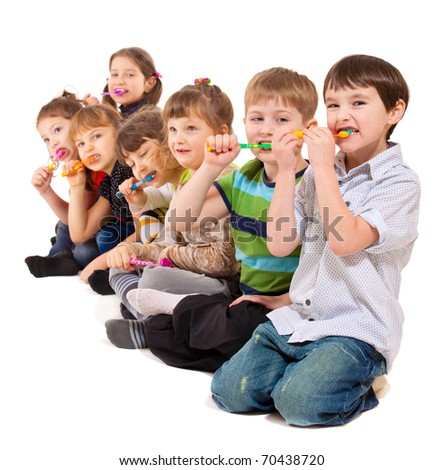 Cute preschool kids group cleaning teeth, isolated - stock photo