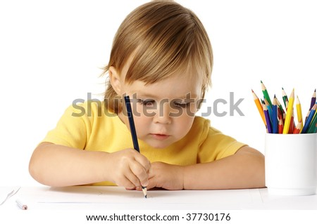 Cute preschooler focused on her drawing, isolated over white - stock photo