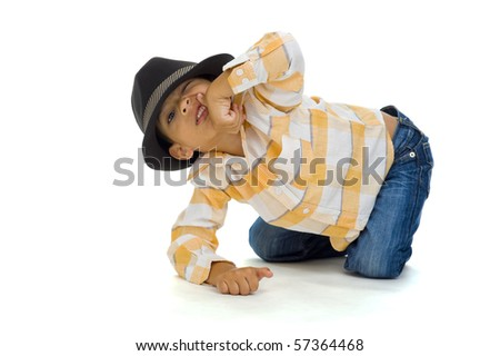 cute preschooler making a grimace, isolated on white background - stock photo