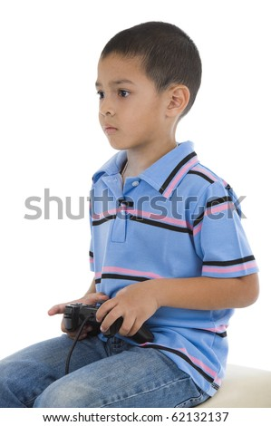 cute preschooler playing a pc game, isolated on white background - stock photo
