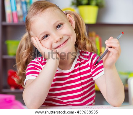 Cute pretty girl drawing with pencils at school - stock photo