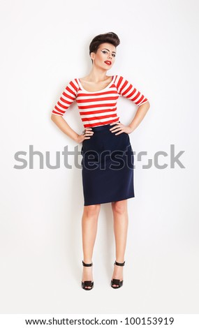 cute pretty woman in t-shirt and skirt - stock photo