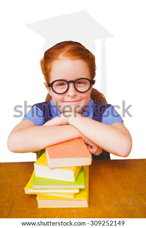 Cute pupil at desk against silhouette of graduate - stock photo