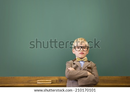Cute pupil dressed up as teacher in classroom at the elementary school - stock photo