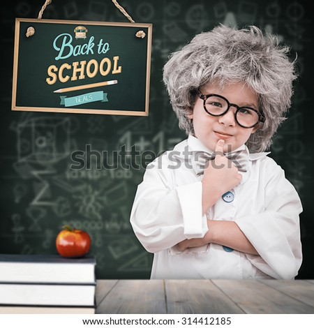 Cute pupil in lab coat against pale grey wooden planks - stock photo