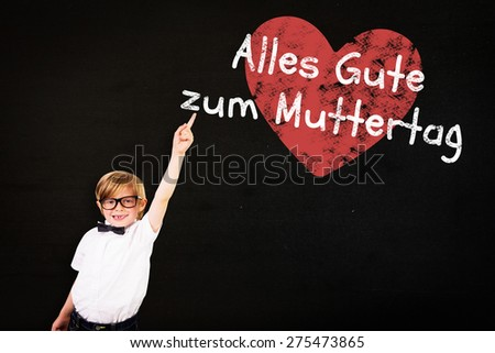Cute pupil pointing against black - stock photo