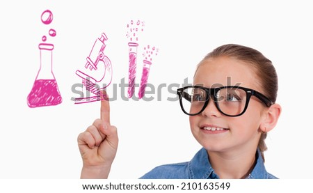 Cute pupil pointing against school doodles - stock photo
