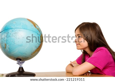 Cute pupil smiling at globe on white background - stock photo
