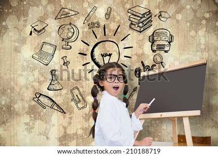 Cute pupil with chalkboard against paint splattered paper - stock photo
