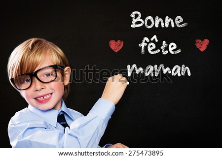 Cute pupil writing against black - stock photo