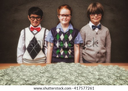 Cute pupils against blackboard - stock photo