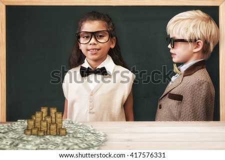 Cute pupils dressed up as teachers against gold coins - stock photo
