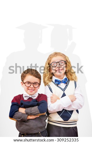 Cute pupils looking at camera against silhouette of graduate - stock photo