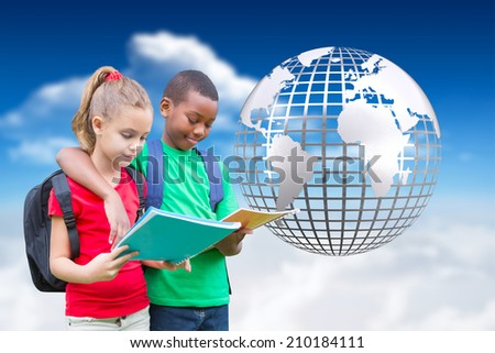 Cute pupils reading against bright blue sky with clouds with globe - stock photo
