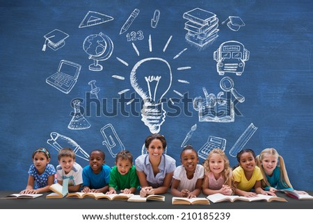 Cute pupils smiling at camera with teacher against blue chalkboard - stock photo