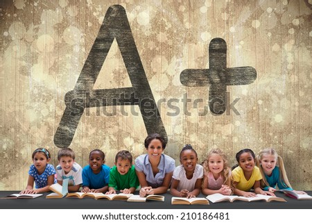 Cute pupils smiling at camera with teacher against paint splattered paper - stock photo