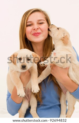 Cute puppies and happy young girl - portrait of young female with her pet dogs