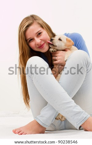 Cute puppy and happy young girl - portrait of teenage girl with her pet dog