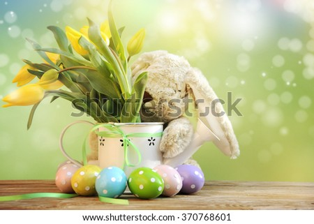Cute rabbit and easter eggs  - stock photo