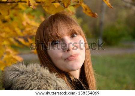 Cute red-haired girl - stock photo