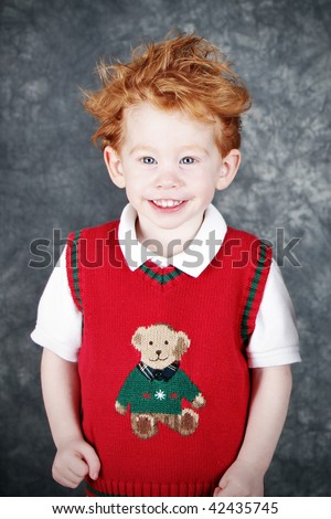 Cute redhead boy in sweater vest Christmas portrait - stock photo